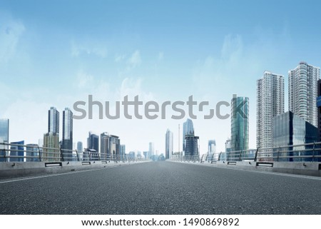 Asphalt road with modern building and skyscrapers on the midtown