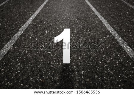 Asphalt road with Number one on the surface. An image of a milestone roadmap is a representation of success in the future goal #1506465536