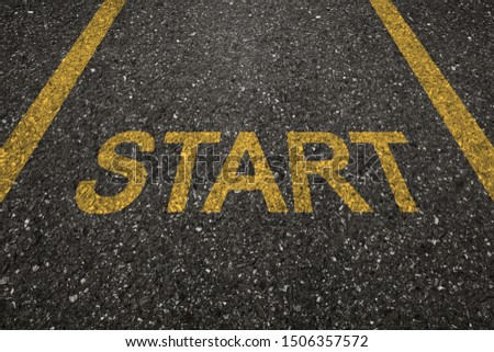 Asphalt road with start letters painted on the surface. An image of a milestone roadmap is a representation of success in the future goal #1506357572