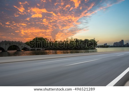 Asphalt road with sunset and beautiful cloud,Car Ad. background #496521289