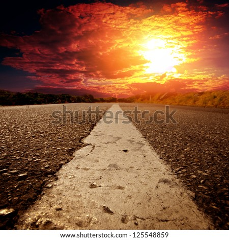 asphalt road with the blue sky