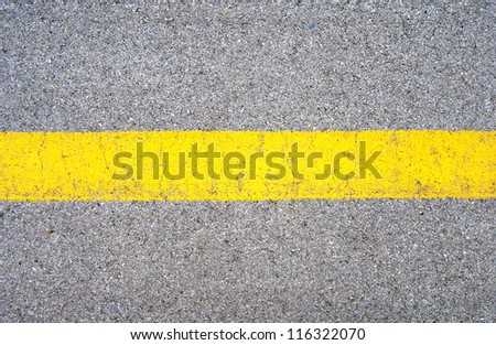 Asphalt road with yellow stripe