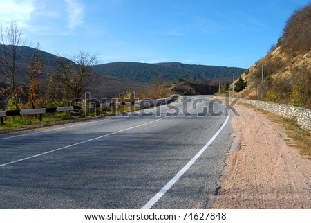 asphalt road without cars among the mountains