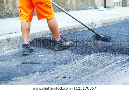 Asphalt road work . Repair urban street #1125170357