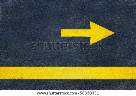 Asphalt road yellow marking. Direction arrow