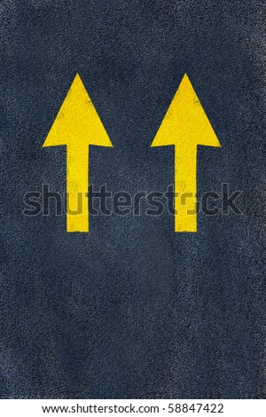 Asphalt road yellow marking. Two arrows, Direction,