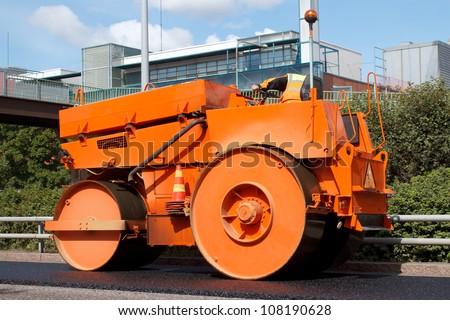 Asphalt roller in road construction site