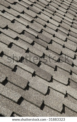 Asphalt shingles on sloped roof - stock photo