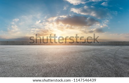 Asphalt square car tire brakes and beautiful colorful sky clouds at sunrise