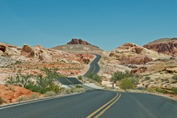 Asphalt Street in Red Rock Canyon with desert scenery