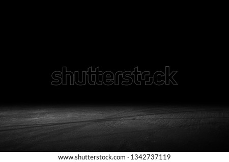 Asphalt surface, racetrack on a black background