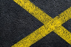 Asphalt texture with yellow cross