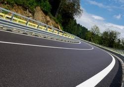 Asphalt twisty mountain road in hills in Slovakia