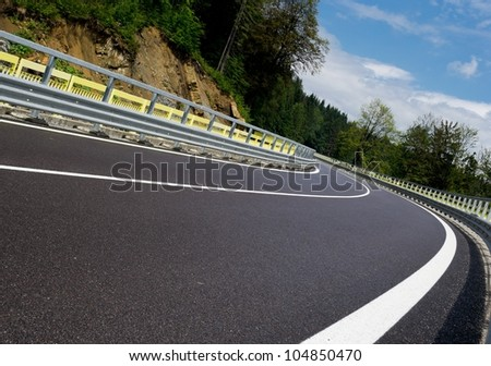 asphalt twisty mountain road in ...