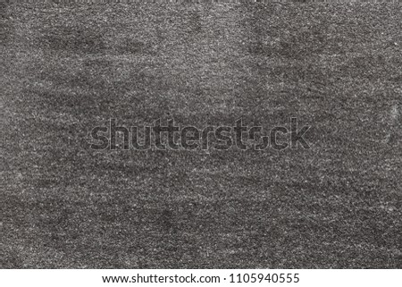 Asphalt with fine grain texture. Close-up of road background in black and white color. Top view of the rough surface