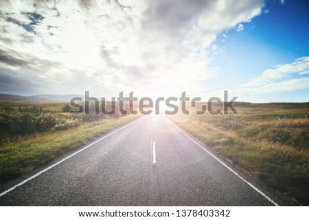 Asphalted, idyllic road in Scotland. Nobody, bright sunbeam.  #1378403342