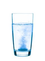 Aspirin in a glass closeup, healthy concept