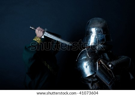 Assassin with knight in the dark