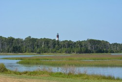 Assateague island lighthouse as seen across the water from Chincoteague, Virginia