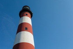 Assateague Light House on Assateague Island on a suunny Day with blue Sky