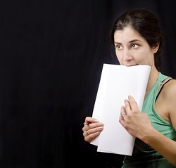 Assay theater. Woman on fabric background. (Role learning themselves or nervous before the test)