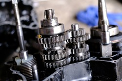Assemble the motorcycle engine gear by a maintenance technician and check it.