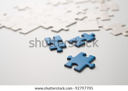 Assemble the puzzle piece by piece - stock photo