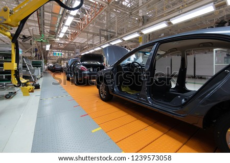 Assembled car is on the Assembly line. Robotic equipment makes the Assembly of the car. Modern car Assembly at the factory