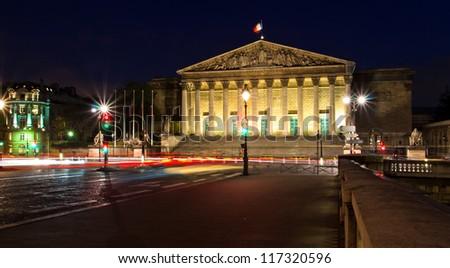 Assemblee Nationale (Palais Bourbon) - the French Parliament seen across Pont de la Concorde at night