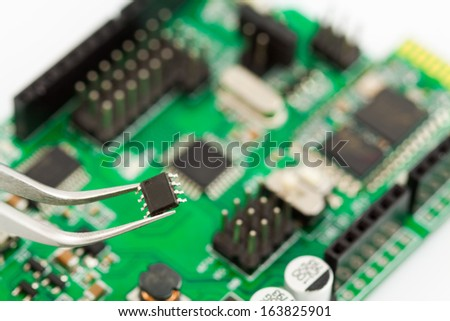 Assembling a circuit board close up
