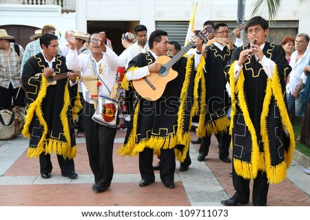 ASSEMINI, SARDINIA - AUGUST 1: A folklore musician group from Ecuador, performs during the International Folk Festival Is Pariglias 2012, on August 1, 2012 in Assemini, Sardinia.