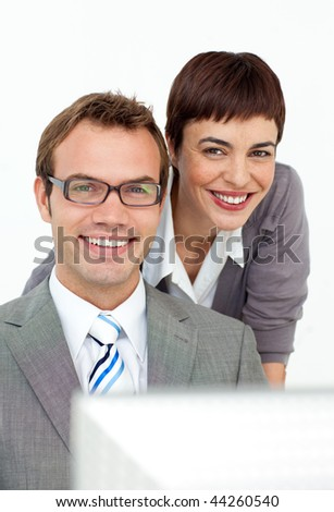 Assertive manager checking her employee's work against a white background
