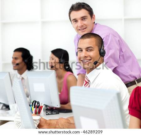 Assertive manager checking his employee's work in the office