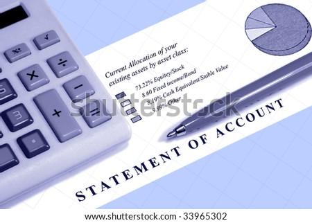 Asset statement, declining graph line, calculator, and pen.