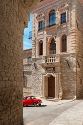 Assisi corner with typical italian old car in red version