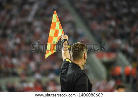Assistant of football referee raise the flag up. Stock foto ©