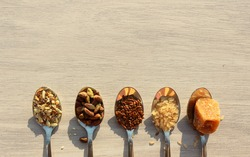 Assorted arrangement of the Super healthy Foods mix seeds, jaggery, flex and pistachio, seeds, brown rice