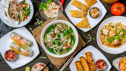 Assorted asian dinner, vietnamese food. Pho ga, pho bo, noodles, spring rolls