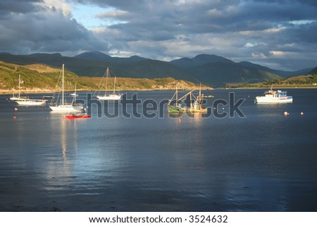 assorted boats on Loch Broom with overcast sky from Ullapool Scotland