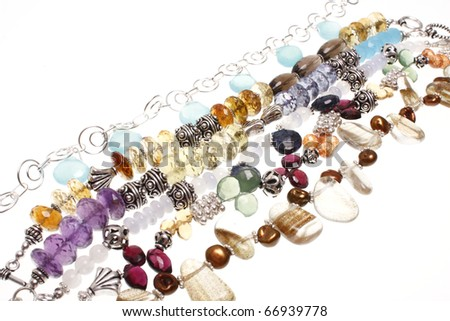 Assorted bracelets consisting of semiprecious stones and silver.