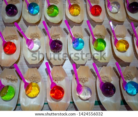 Assorted, brightly colored water jelly raindrop cakes for sale at Nambu night market in Jeonju, South Korea
