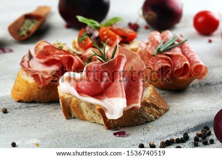 Assorted bruschetta with various toppings. Appetizing bruschetta or crudo crostini. Variety of small sandwiches. Mix bruschetta Stock fotó ©