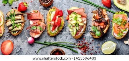 Assorted bruschetta with various toppings.Appetizing bruschetta.Variety of small sandwiches.Mix bruschetta Stock fotó ©