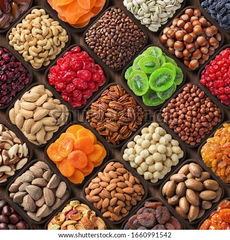 assorted candied berries, dried fruits, nuts and seeds, top view. healthy food background