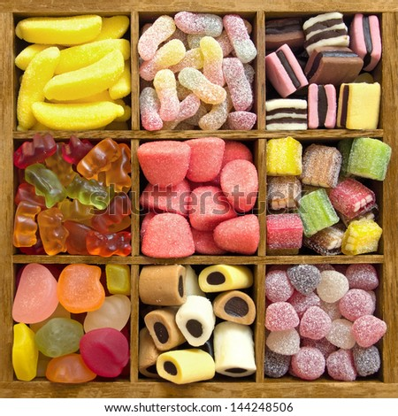 Assorted candy sweets in a wooden box