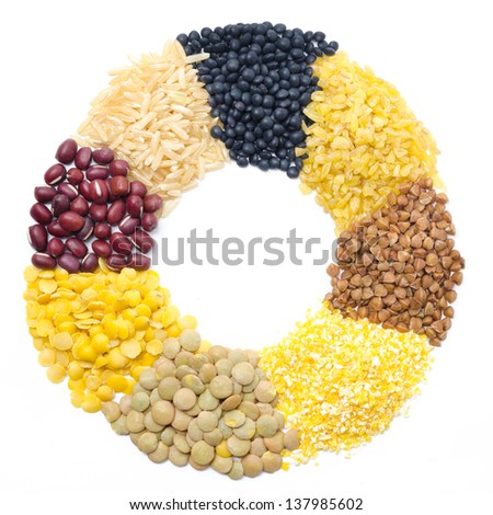 assorted cereals and legumes in form of a circle and space for text isolated on white