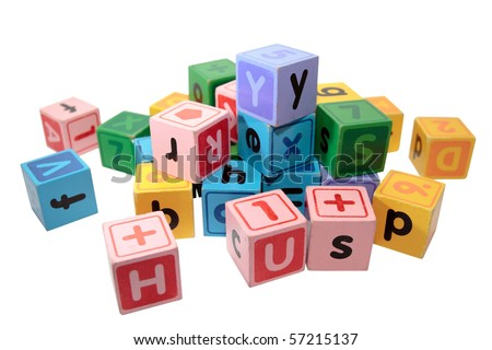 assorted children toy letter building blocks against a white background