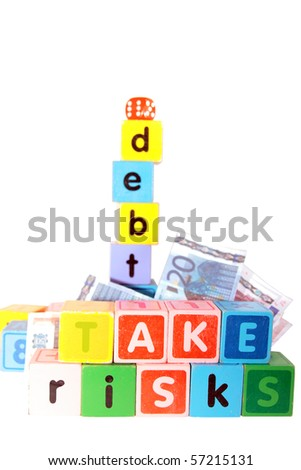 assorted children toy letter building blocks against a white background that spell take risks and debt - stock photo