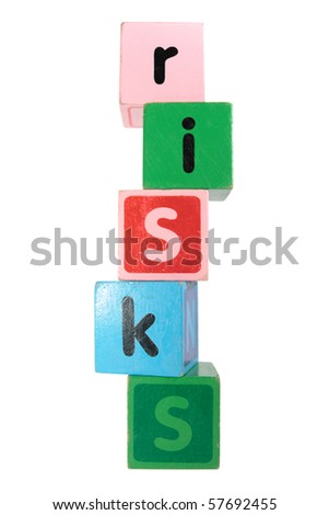 assorted childrens toy letter building blocks against a white background that spell risks