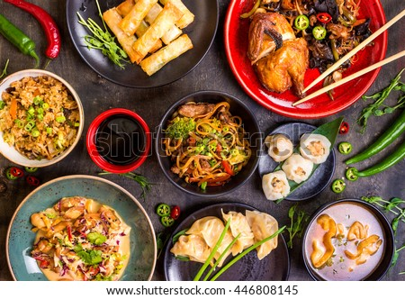 Assorted Chinese food set. Chinese noodles, fried rice, dumplings, peking duck, dim sum, spring rolls. Famous Chinese cuisine dishes on table. Top view. Chinese restaurant concept. Asian style banquet ストックフォト ©